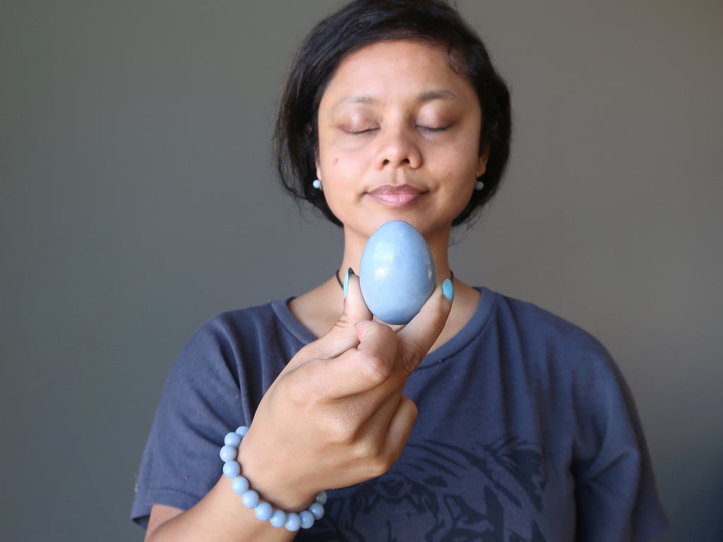 sheila of satin crystals meditating with an angelite egg
