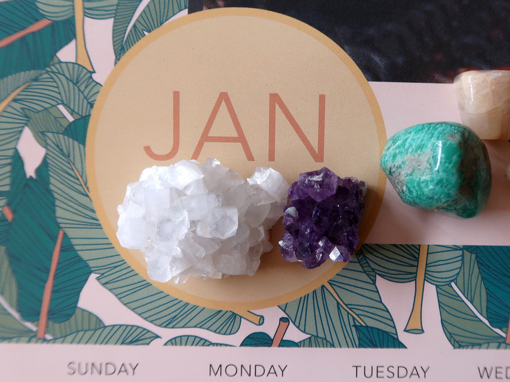 january calendar page with healing crystals on top