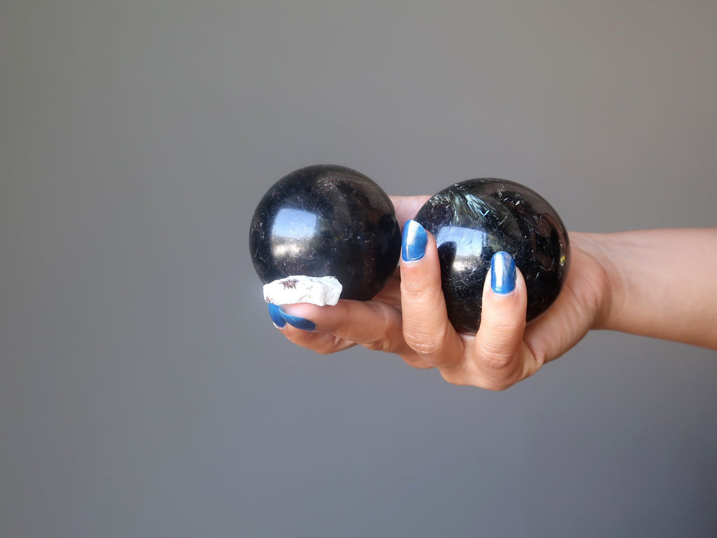 astrophyllite raw stone and stone spheres