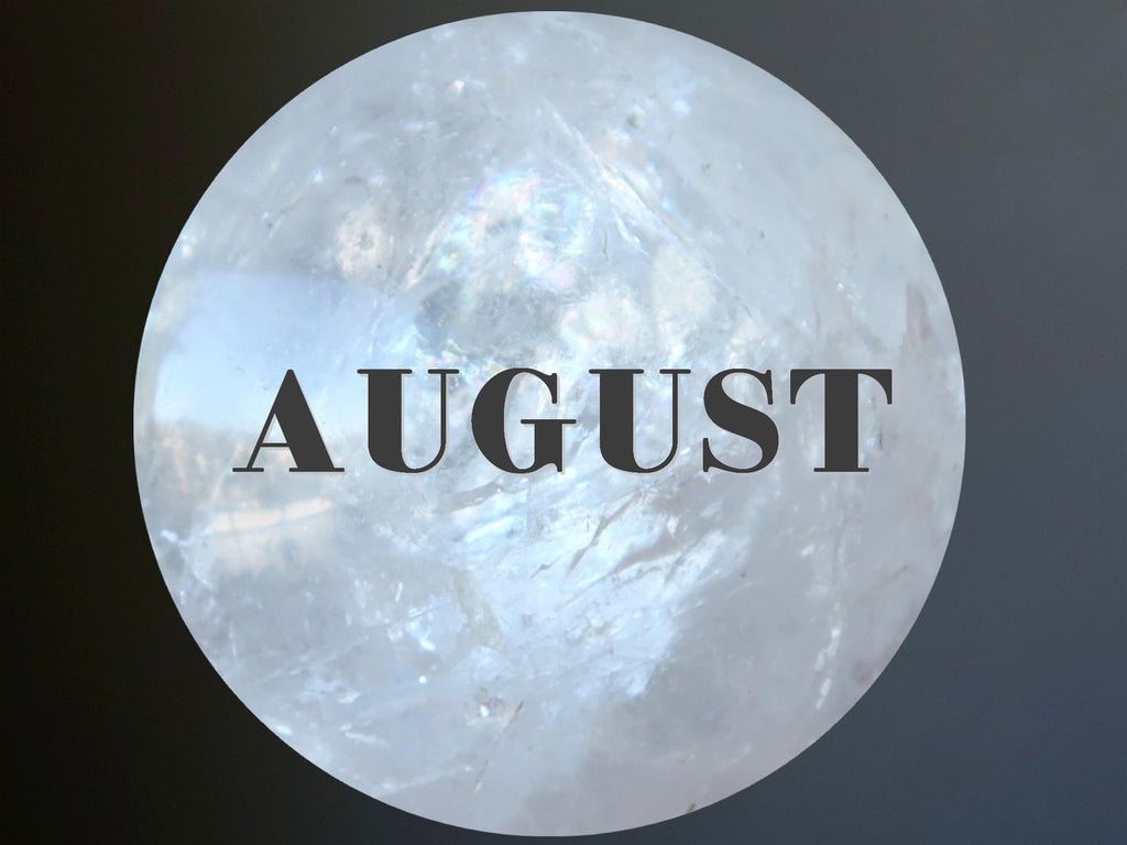 quartz sphere with word AUGUST over it