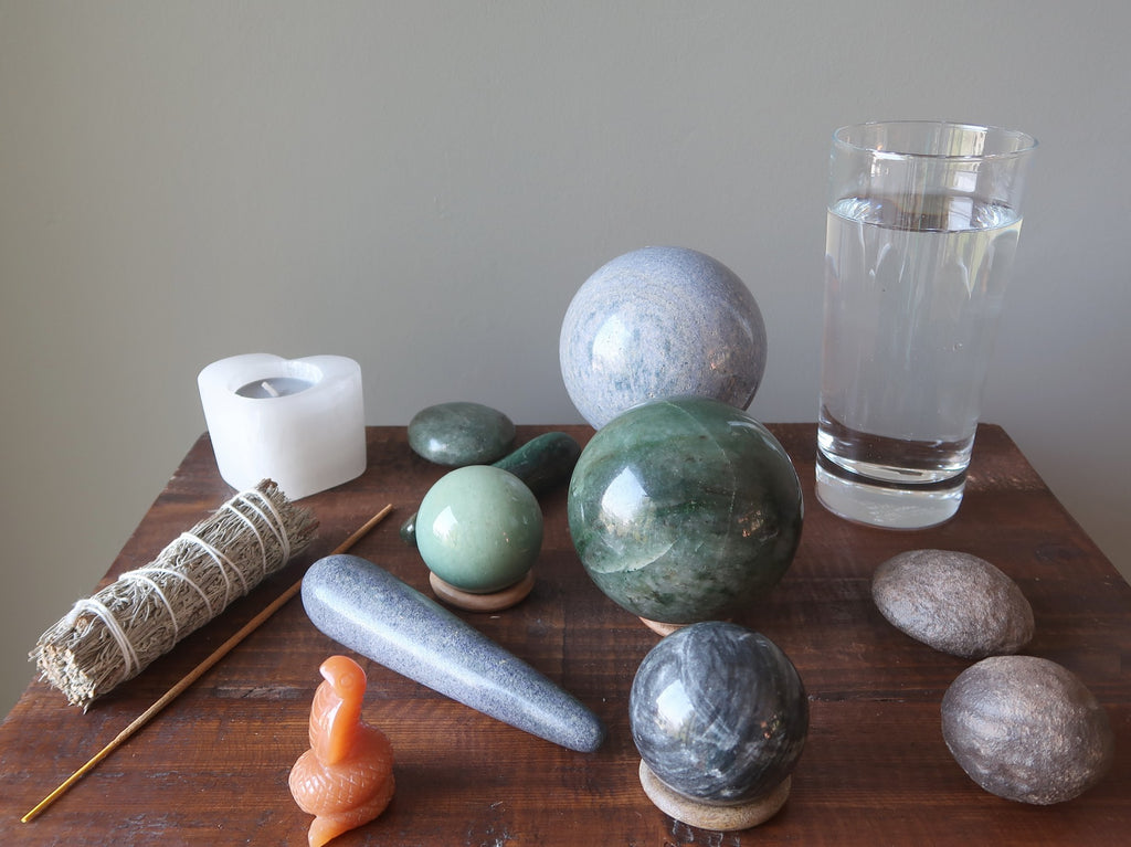 aventurine crystals, moqui marbles, water, candle, sage, incense to prepare for meditation