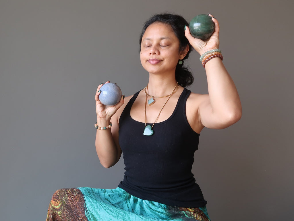 sheila of satin crystals meditating with blue and green aventurine balls