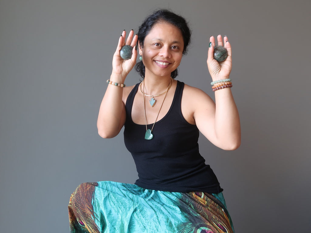 sheila of satin crystals holding grey aventurine stones in her hands
