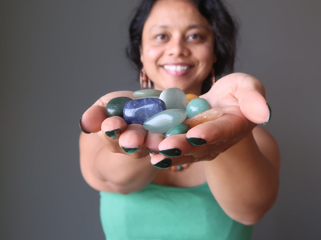 sheila of satin crystals with handful of blue and green aventurine tumbled stones for healing