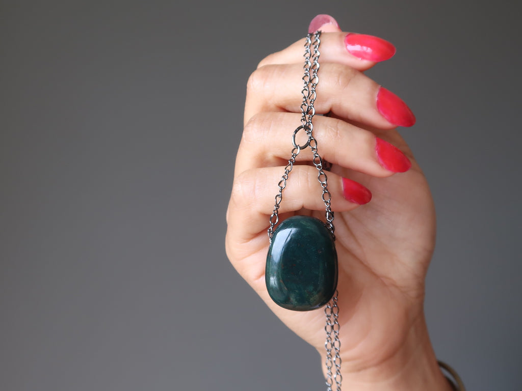 hand holding a bloodstone gunmetal chain necklace