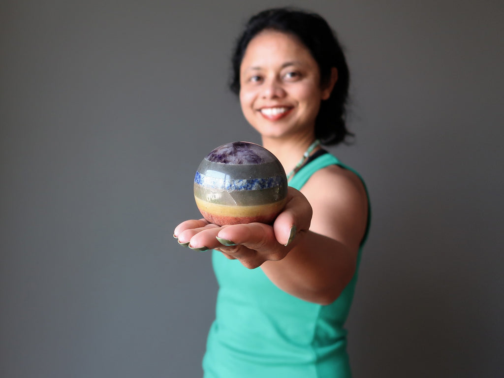 sheila of satin crystals holding out a 7 layered chakra crystal ball