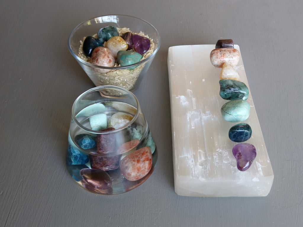 chakra stones on selenite, in water and in brown rice
