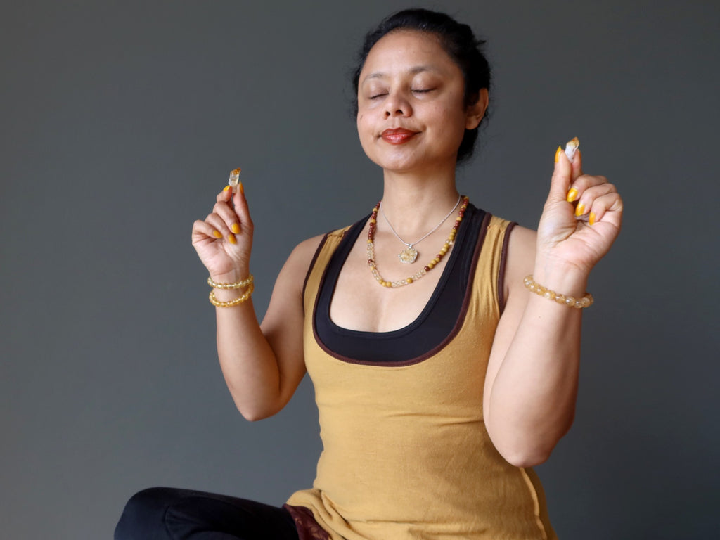 sheila of satin crystals meditating with citrine raw points