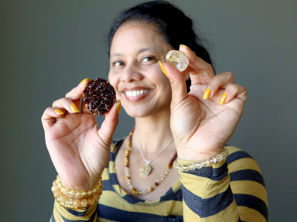 sheila of satin crystals holding citrine