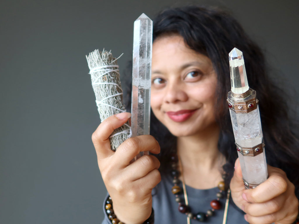clearing the home with quartz wands and sage at satin crystals
