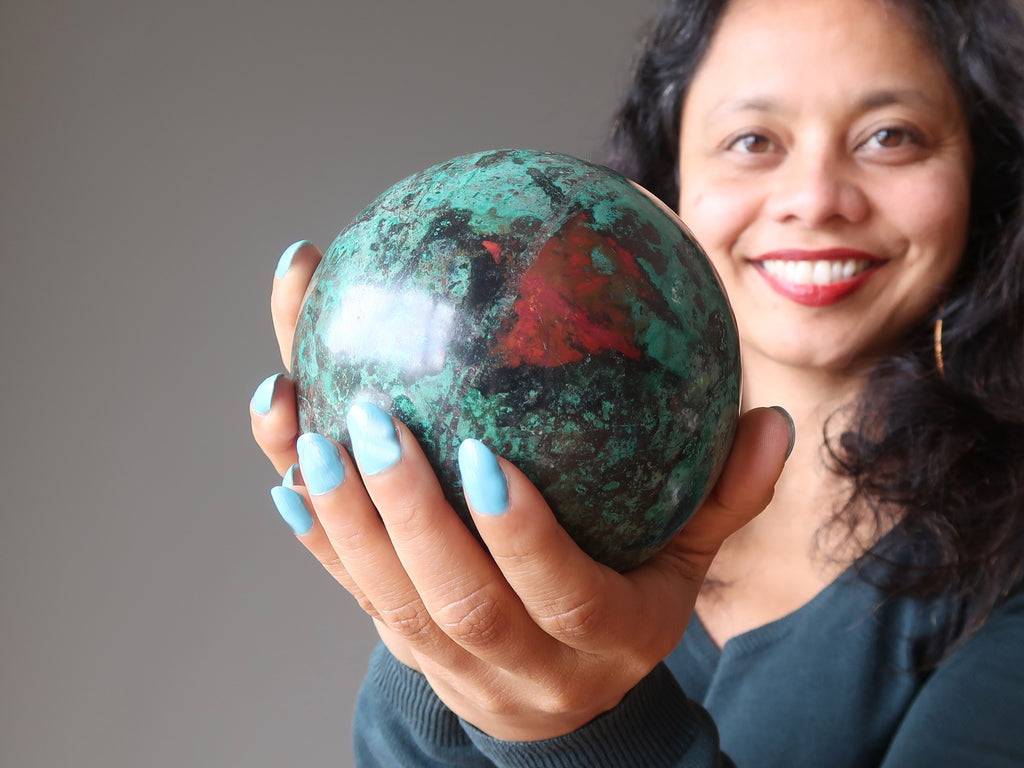 sheila of satin crystals holding a sonora sunrise chrysocolla sphere