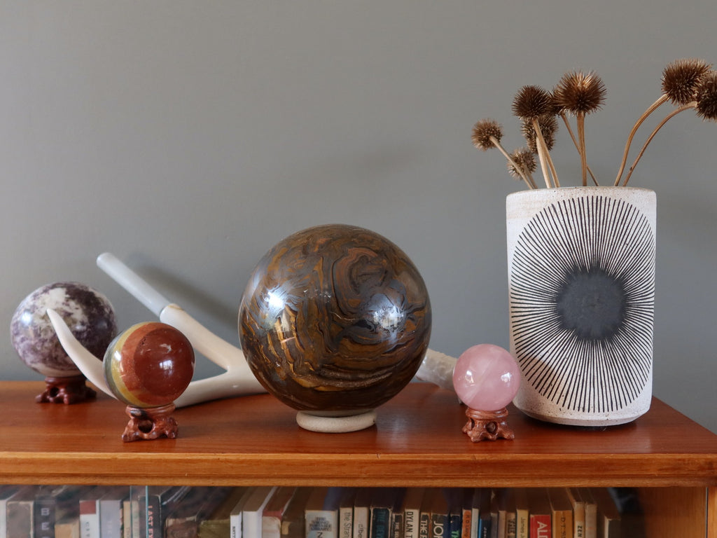crystal balls on a bookcase