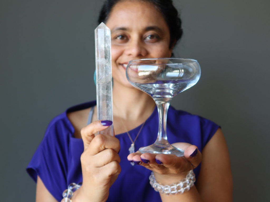 sheila of satin crystals holding real quartz wand and glass martini