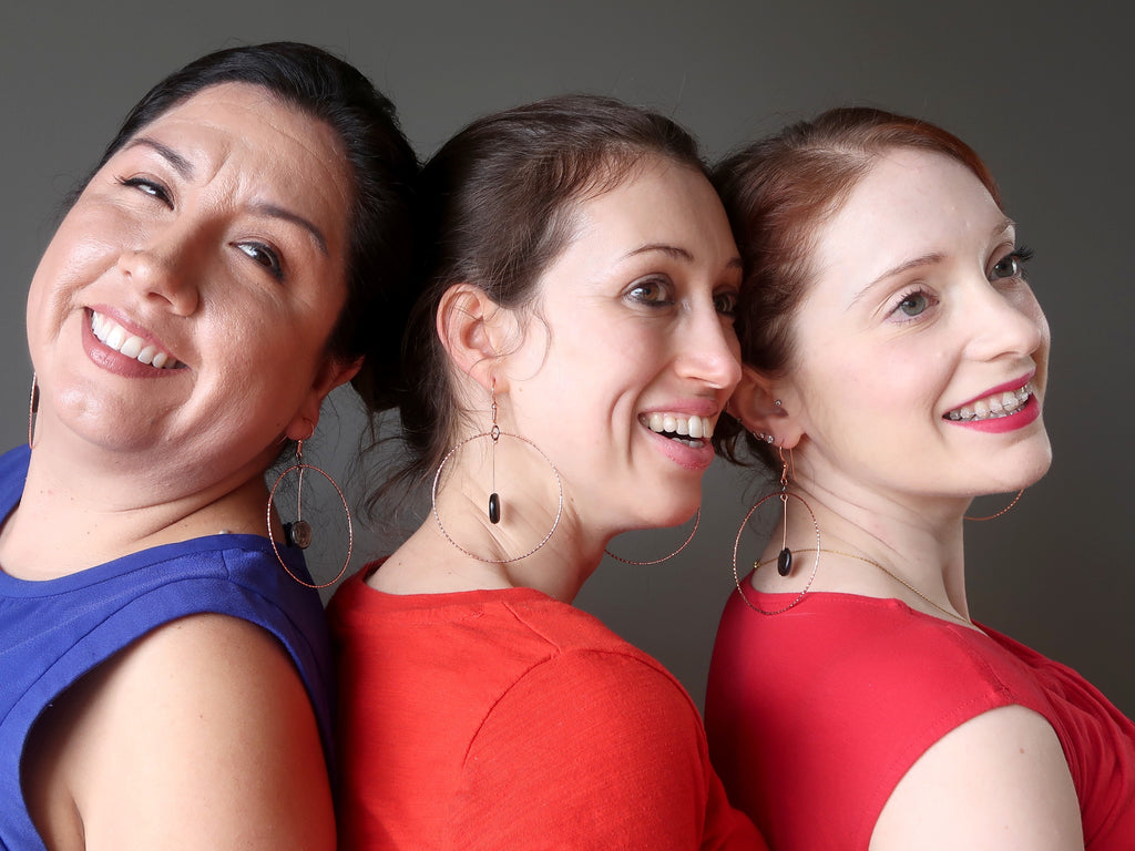 valerie, holly and gemma of satin crystals wearing big mica hoop earrings