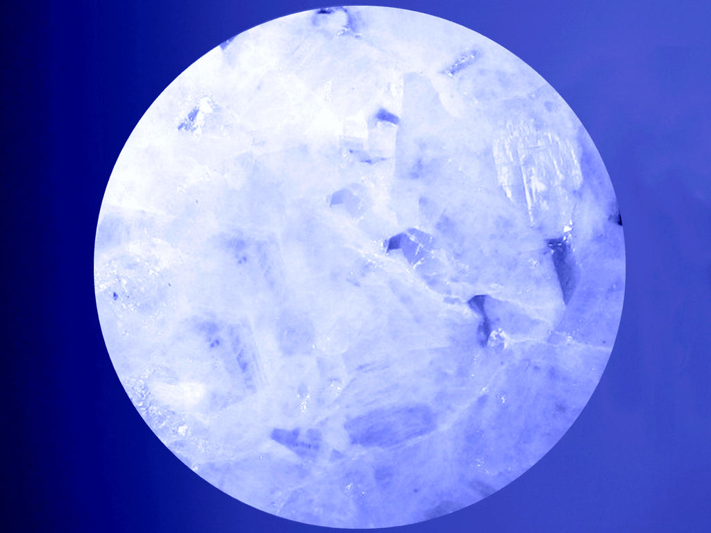 rainbow moonstone sphere on blue background