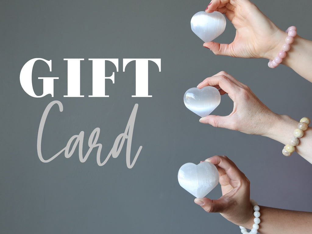 Gift Card with three hands holding three selenite hearts