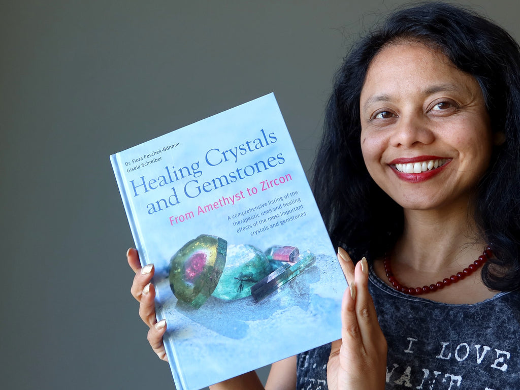 sheila of satin crystals holding a healing crystals book