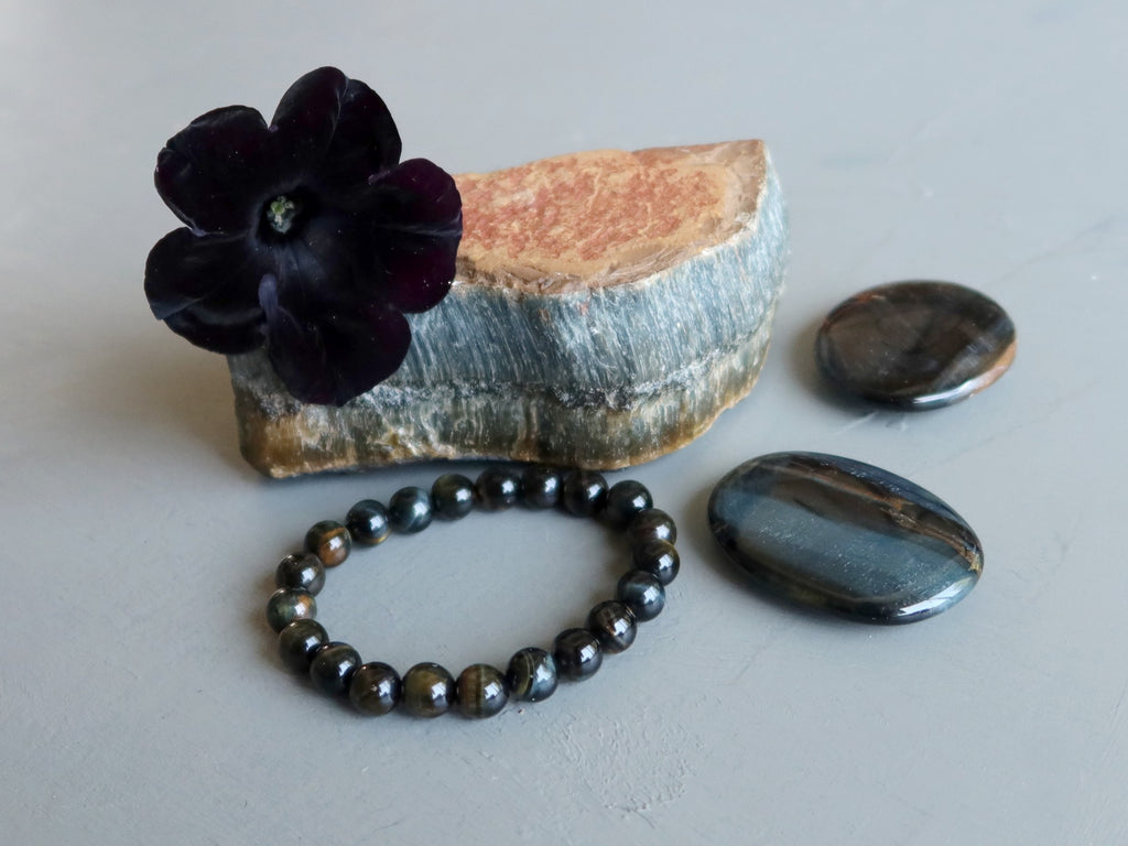 hawks eye stones and bracelet and black flower