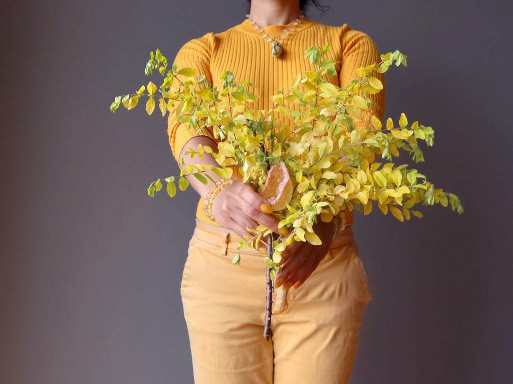 sheila of satin crystals holding a yellow bouquet of flowers and crystals