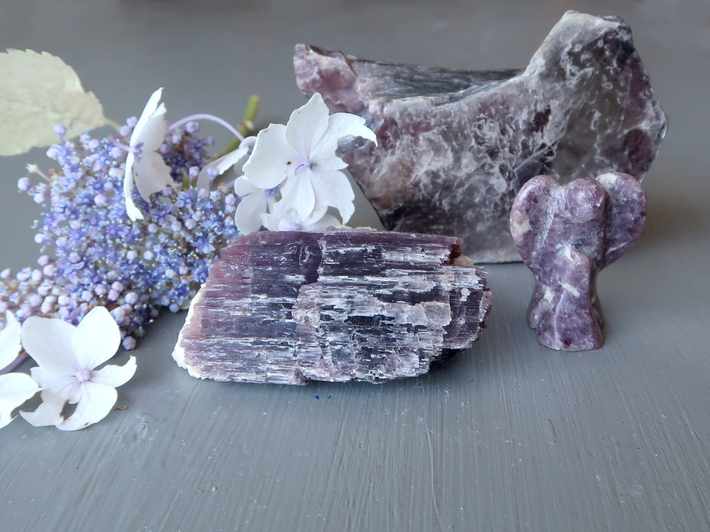lepidolite stones and angel with flowers for the third eye chakra