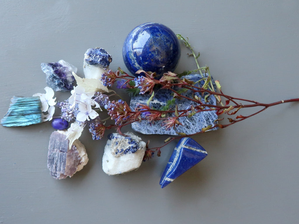 blue and purple stones and flowers for the third eye chakra