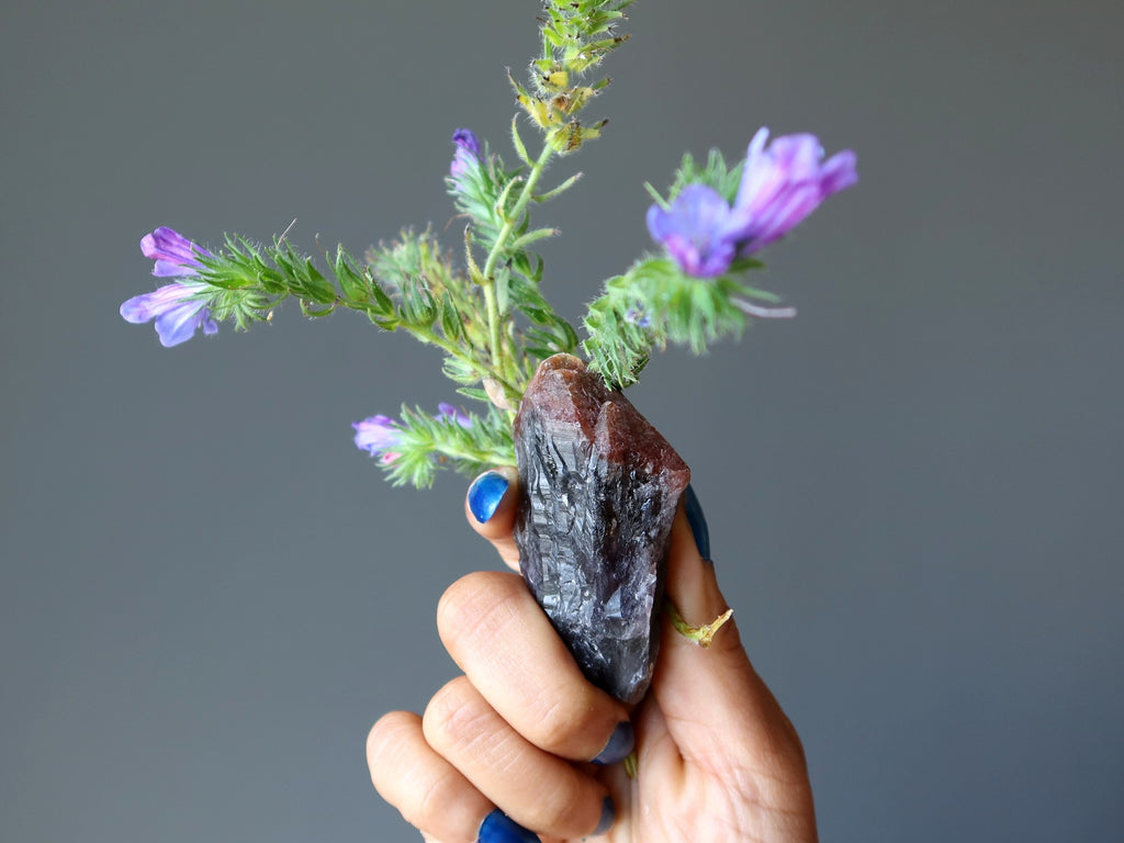 amethyst super 7 raw point and purple flower bouquet