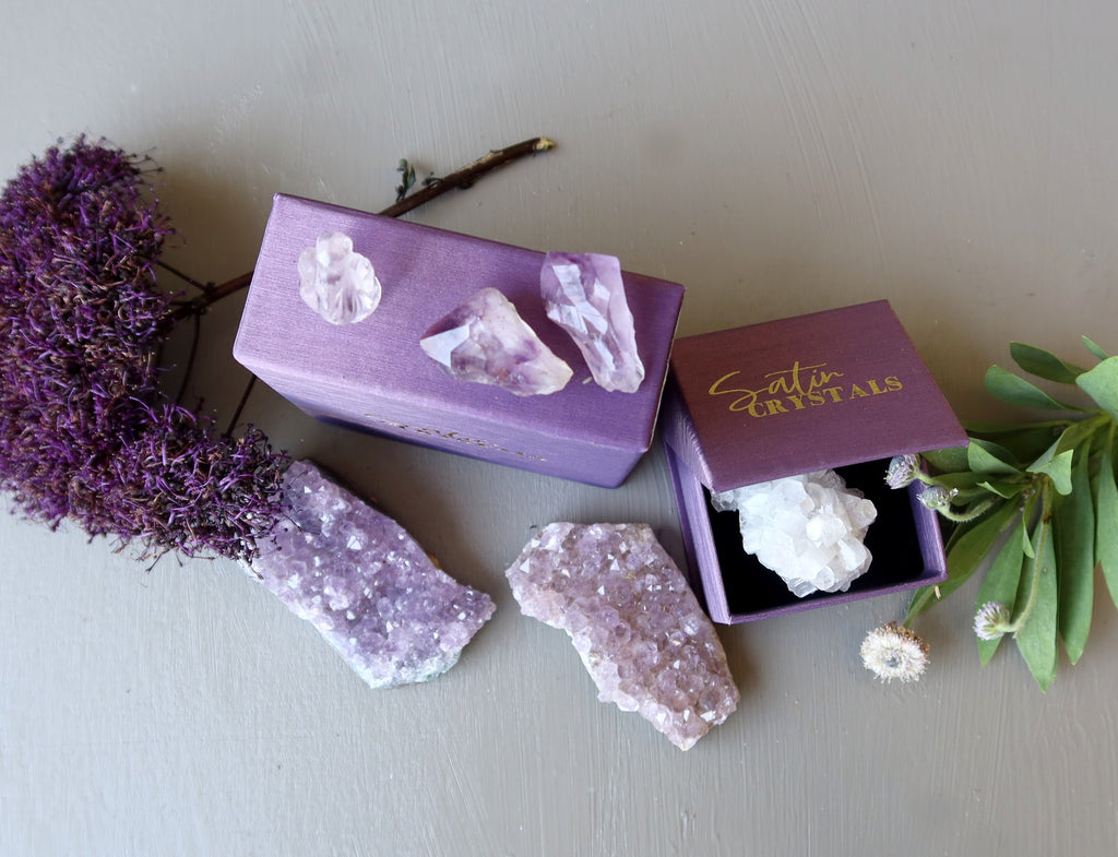 amethyst, calcite crystals, flowers and purple satin crystals gift boxes