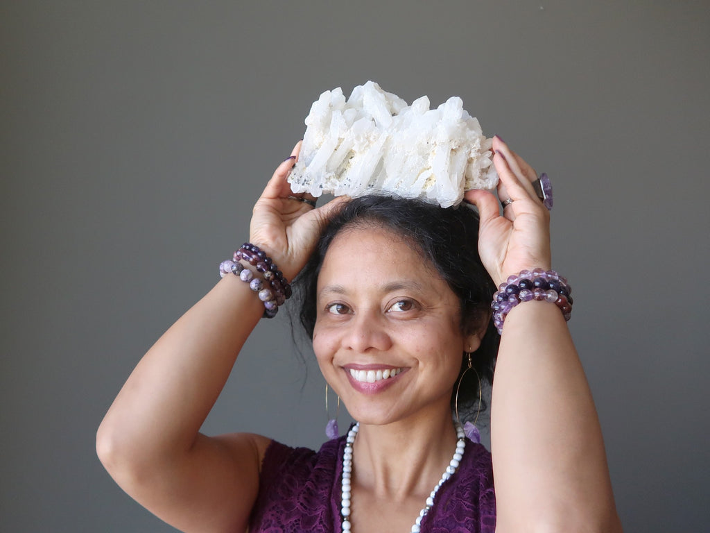 sheila of satin crystals with a white quartz cluster at her crown chakra