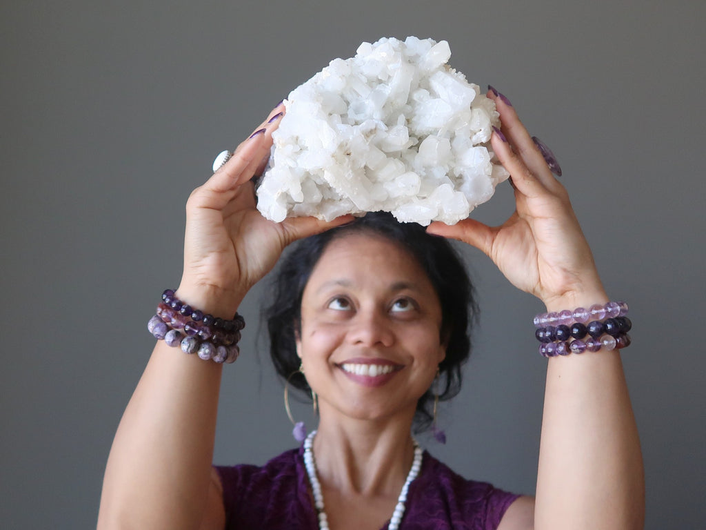 sheila of satin crystals with a quartz cluster at her crown chakra