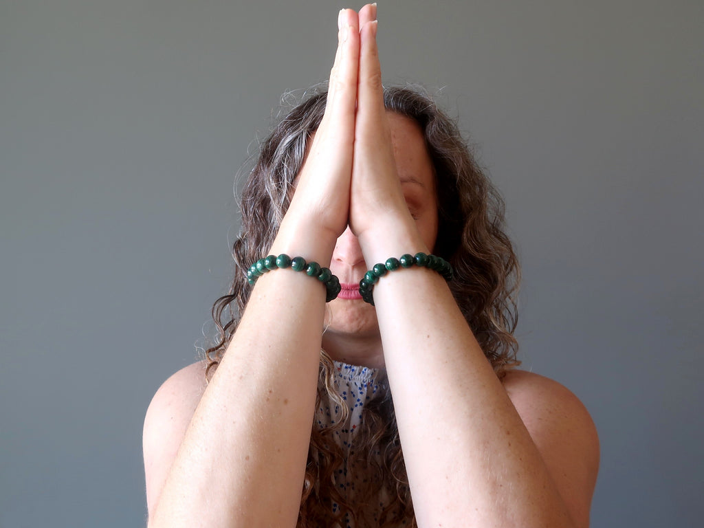 aleks of satin crystals meditating with malachite stretch bracelets