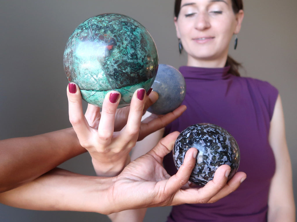 lucia of satin crystals meditating with chrysocolla, blue aventurine and gabbro stone spheres