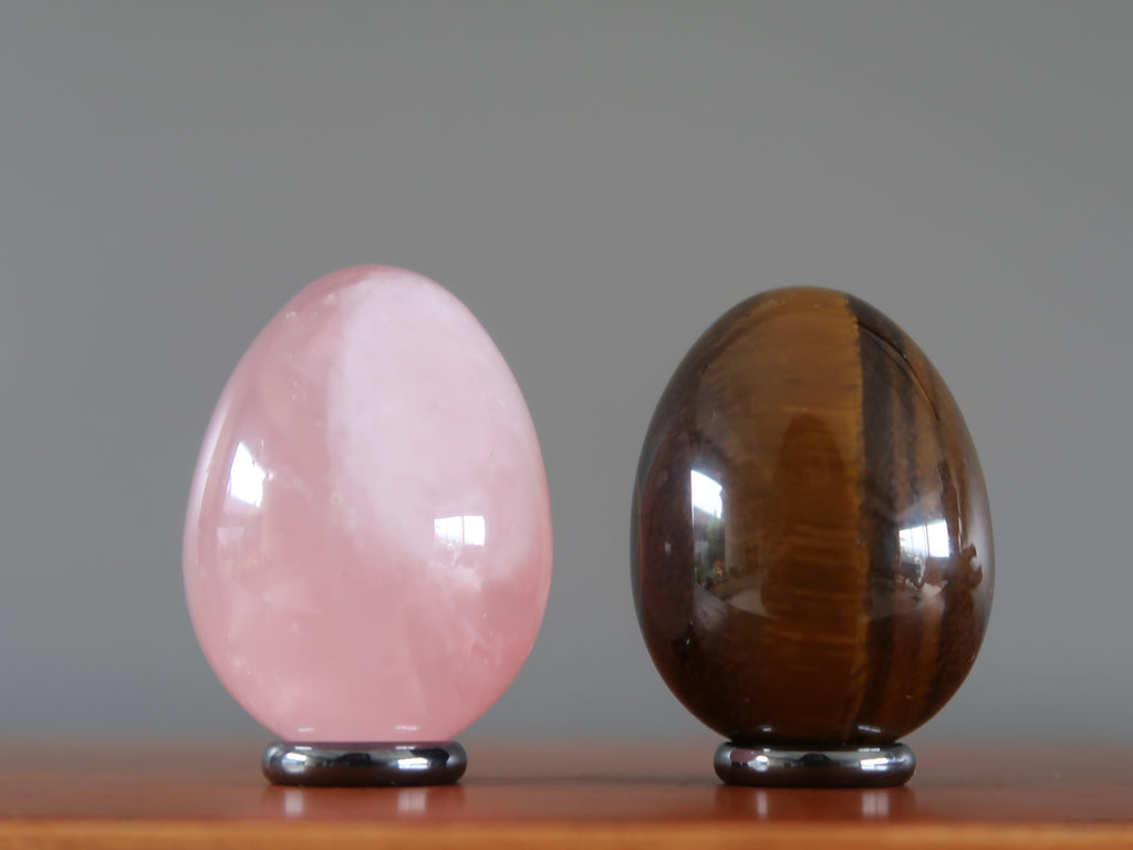 pink rose quartz and brown golden tigers eye crystal healing eggs on ring stands