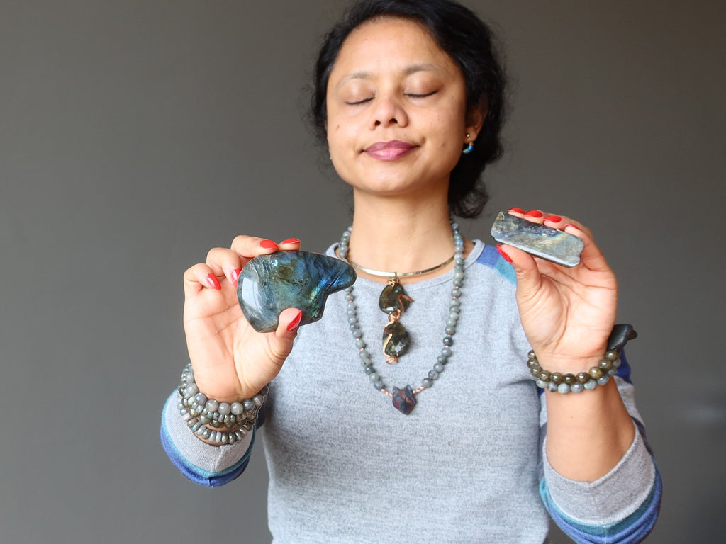 sheila of satin crystals meditating with labradorite bear and stone