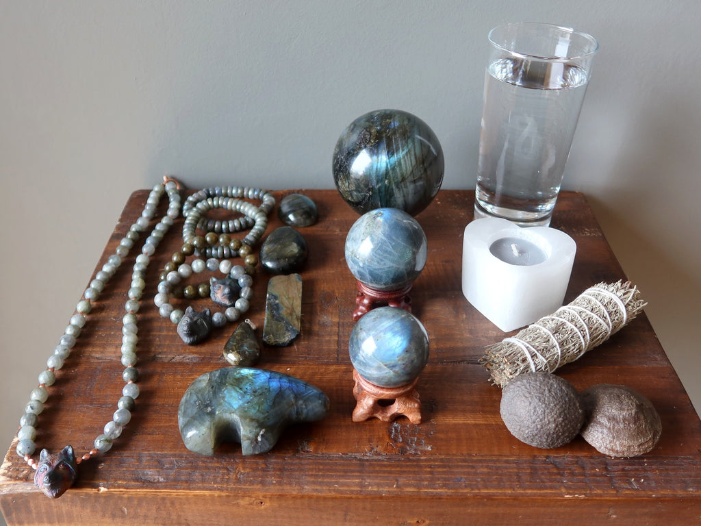 labradorite jewelry, stones, moqui marbles, sage, candle, water for meditation