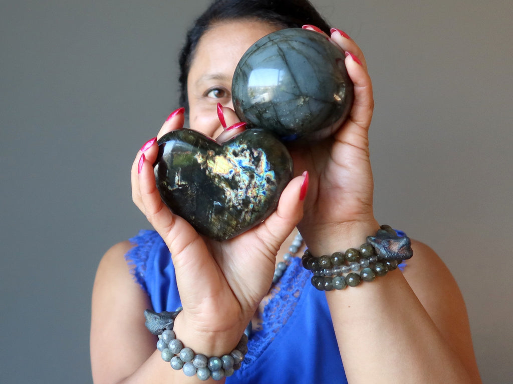 sheila of satin crystals holding up a labradorite sphere and heart