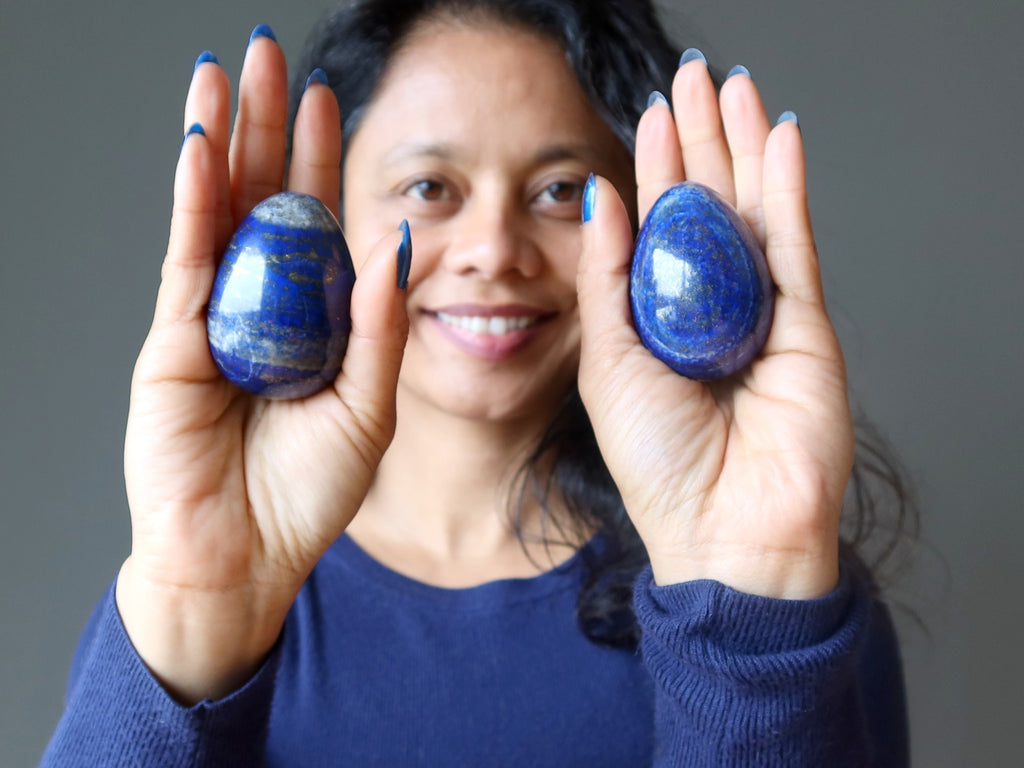 sheila of satin crystals with two lapis lazuli eggs in her palms