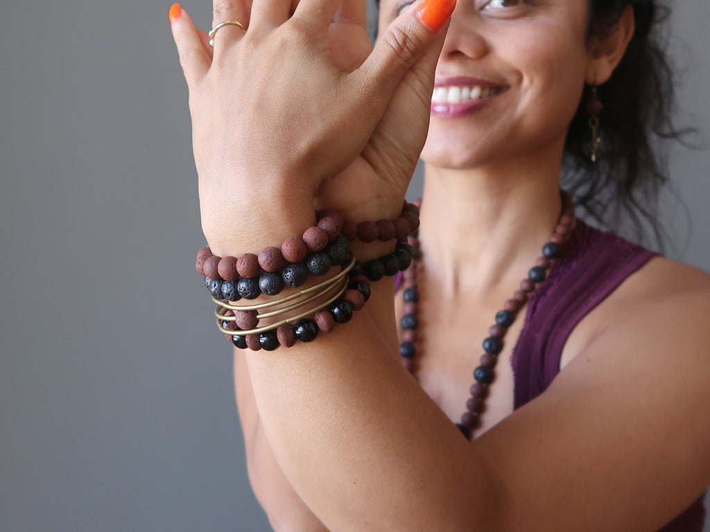 sheila of satin crystals wearing lava bracelets and necklace