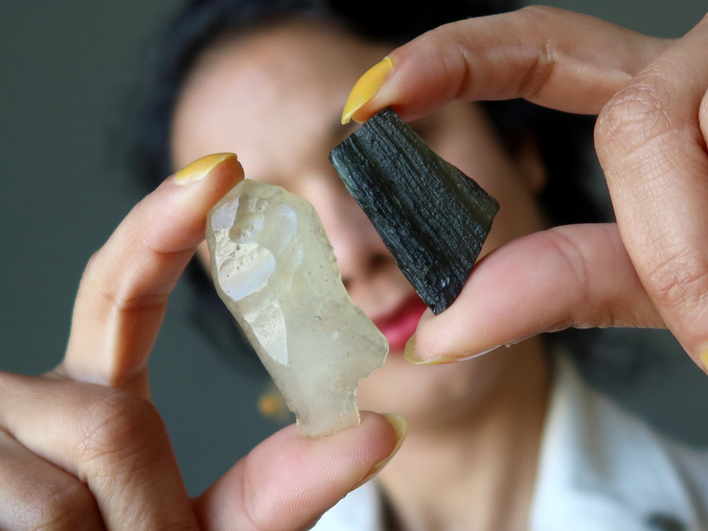 female holding libyan desert glass and moldavite tektites