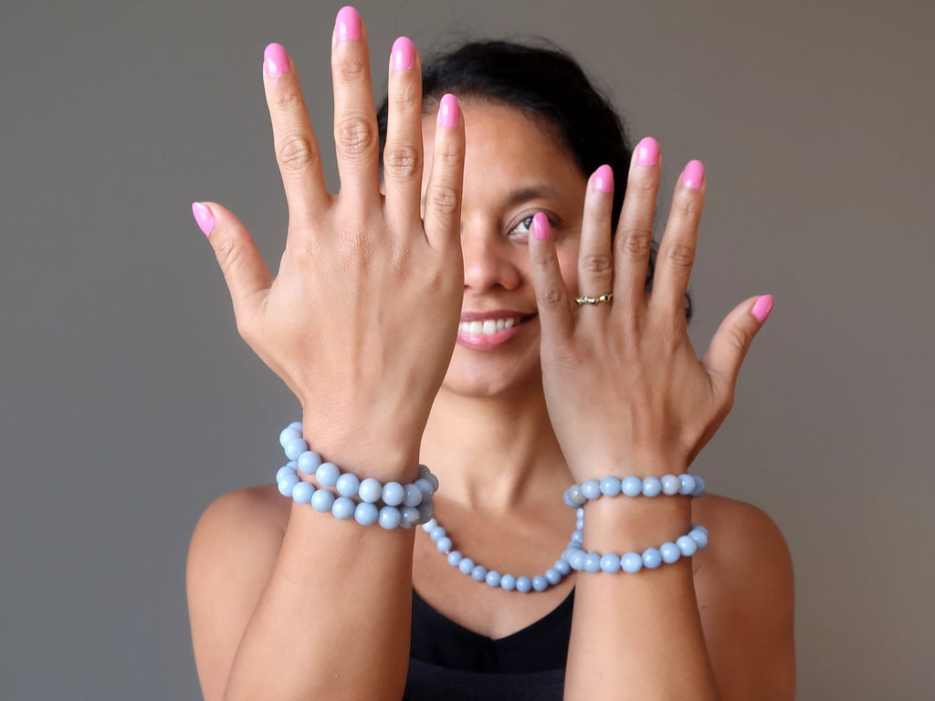 sheila of satin crystals showing off stackable angelite stretch bracelets