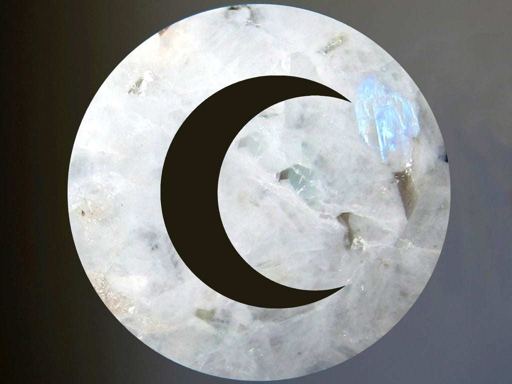 rainbow moonstone sphere with a new moon cutout
