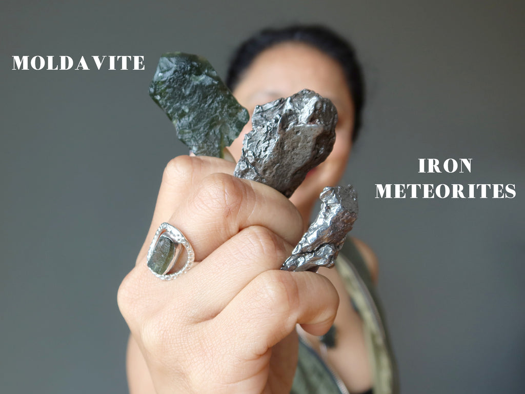 sheila of satin crystals holding moldavite and iron meteorites