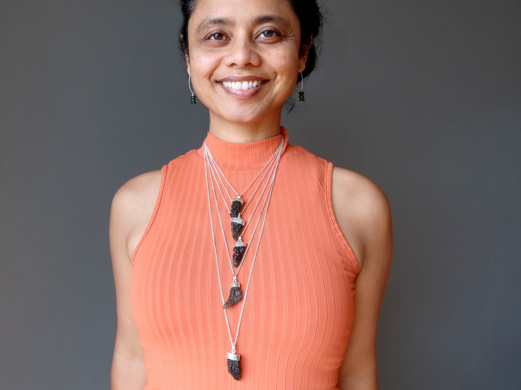 sheila of satin crystals wearing moldavite necklaces and earrings