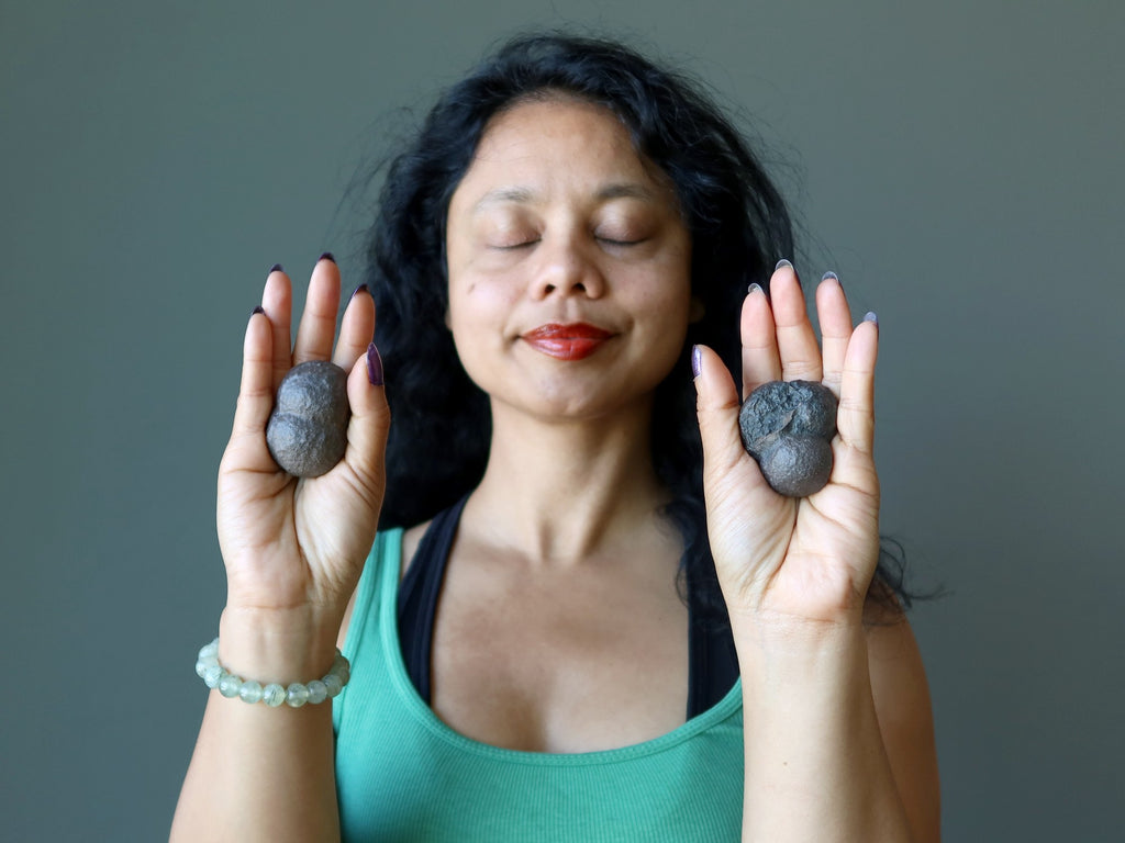 sheila of satin crystals meditating with moqui marbles in her palms