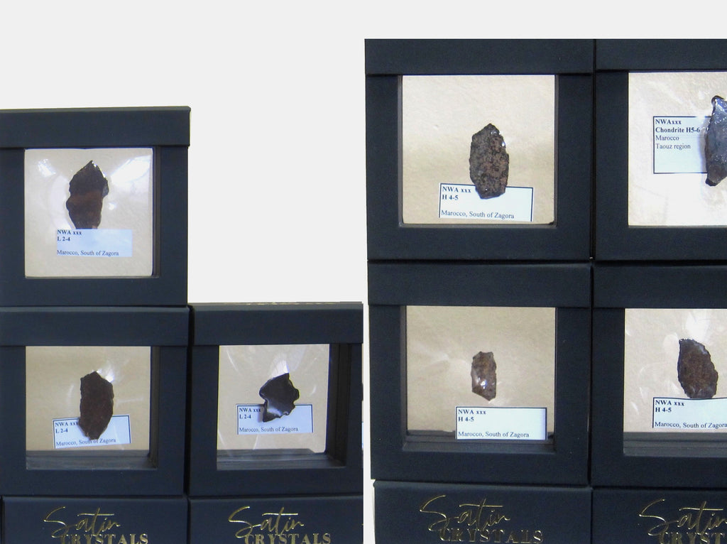 north west african chondrite meteorites in suspension display boxes for sale at satin crystals