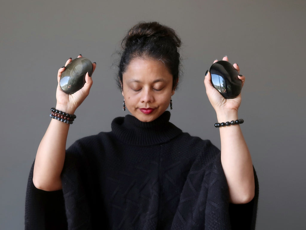 Sheila of Satin Crystals meditating with Golden Sheen Obsidian palm stones
