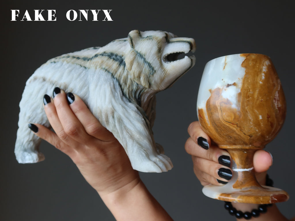 hands holding a cave onyx bear and cup as fake onyx examples