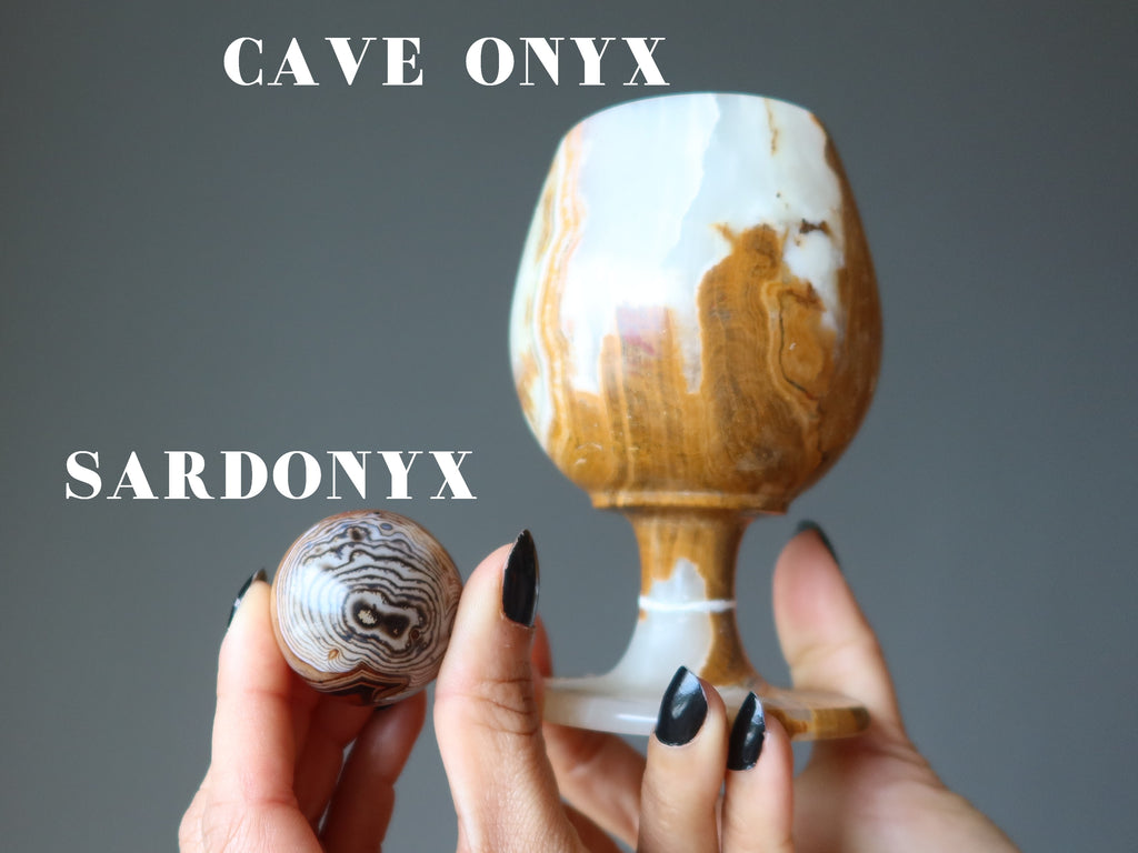 hands holding up a sardonyx sphere and a cave onyx goblet