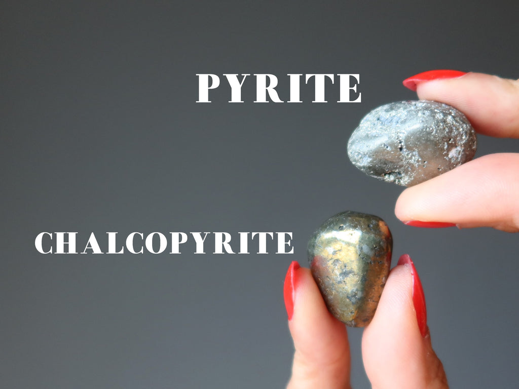 hands holding pyrite and chalcopyrite tumbled stones