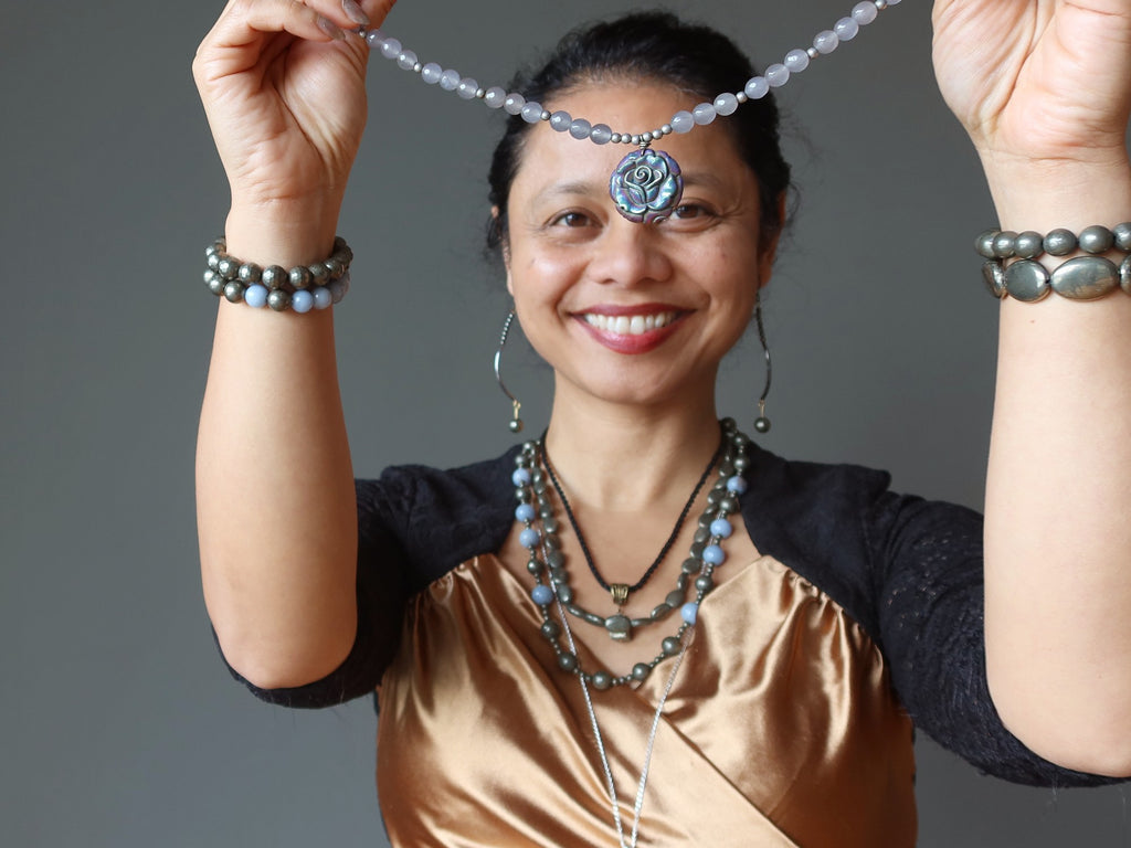 sheila of satin crystals wearing pyrite jewelry
