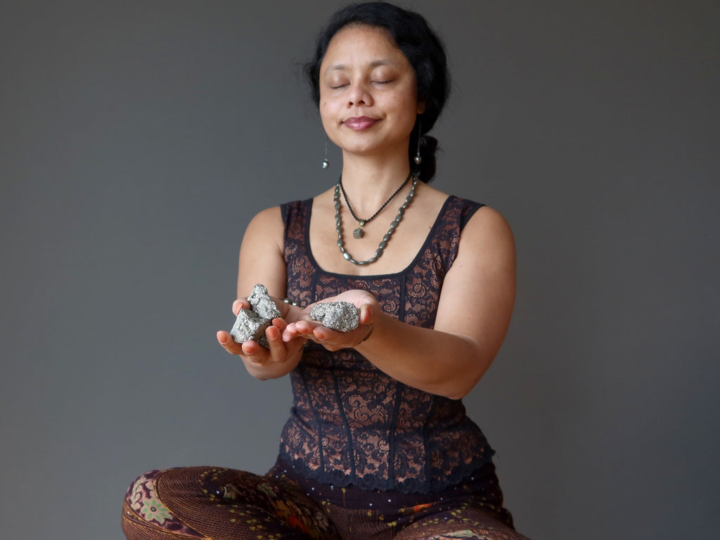 sheila of satin crystals meditating with pyrite clusters